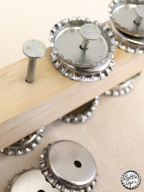 Close up of bottle cap shaker instrument.